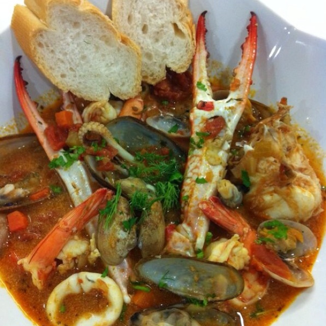 Italian seafood stew with French bread. I love crab claws! For good ...