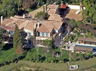 Sylvester Stallone  The house that Rocky built... Sylvester Stallone's $10,000,000.00 million pad -- 15,121 sq. ft. of sparring space, and plenty of room for supplements.