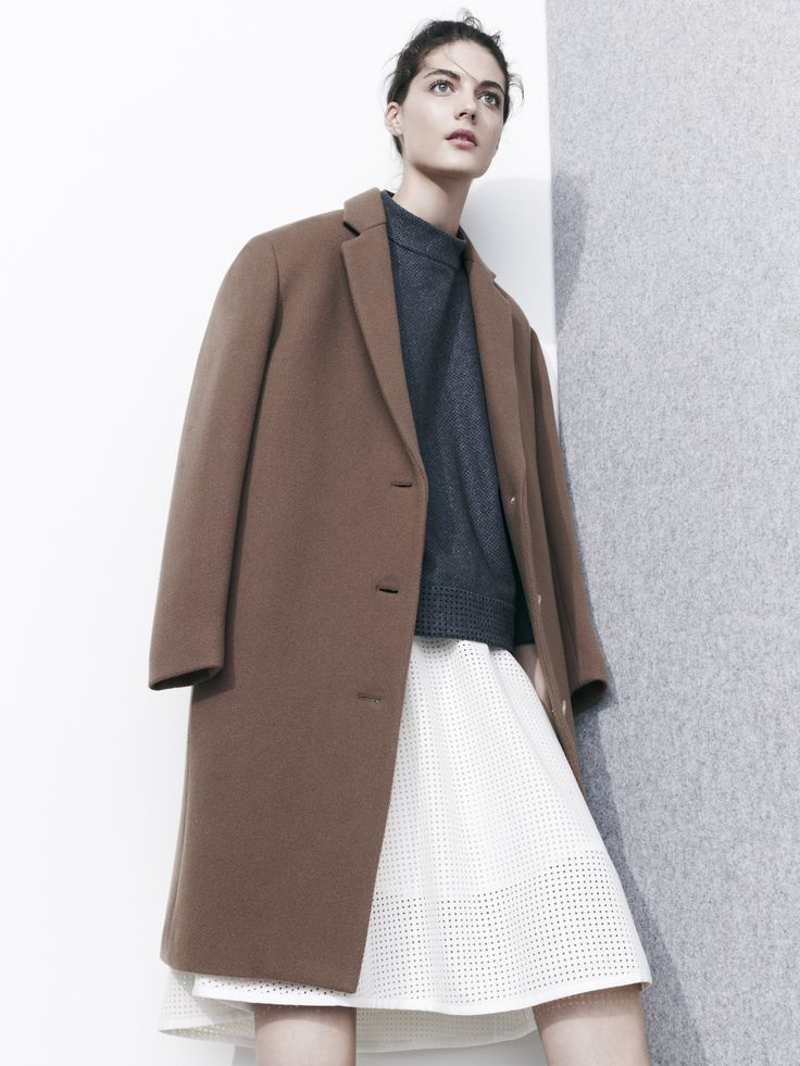 J.Crew stadium-cloth topcoat in vicuna, J.Crew Collection perforated top in heather carbon and perforated skirt in warm ivory.