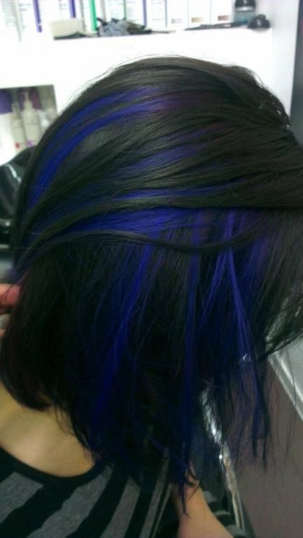 Black hair with blue peekaboo highlights.