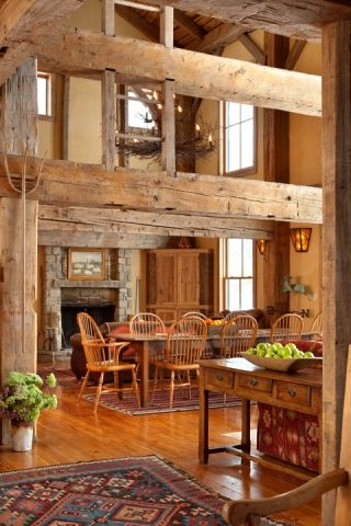 Reclaimed barn and log home.  Love, love those big beams!