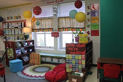 """Such a smart classroom setup! 1)WOW Wall, bulletin board featuring some of each student's best work, so not neces the same assignment, 2) super homey reading area with books organized by topic and/or author, 3) book """"check-out"""" system where all students have an envelope and """"check-out card"""" where they write the name and date of a book they are taking home from class library for pleasure or an assignment..helps keep books from disappearing, 4)""""I PICK"""" I choose, Purpose, Interest, Comprehend, Know"""
