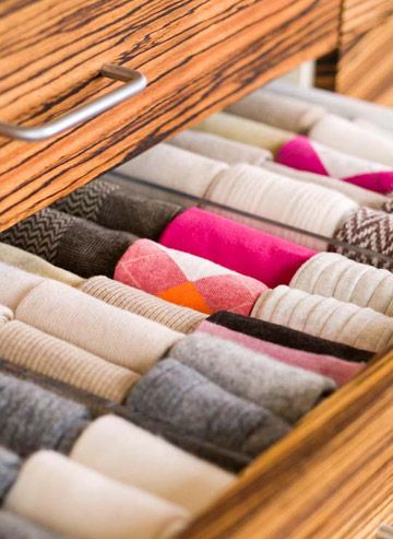 Sock Organizer-A clear acrylic sock organizer keeps socks and stockings in line, making digging through drawers a pain of the past. Also, weed out your stash of widowed socks. They take up space and you may never find their partners.