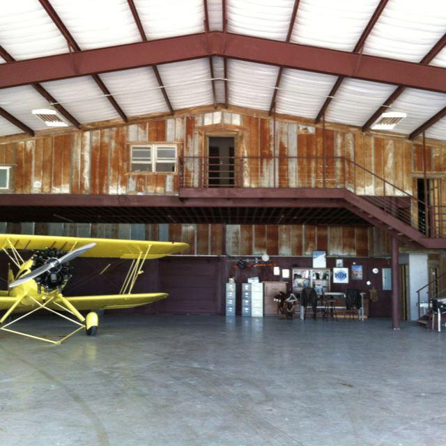 Hangar with waco garage workshop hangar armory for Aircraft hangar home designs