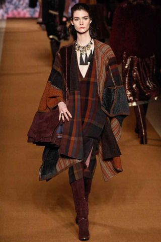 Etro's plaid blanket flair with seasonal wines and burnt siennas grounding the palette, tasseled fabulous necklace and high shaft suede boots. Everything good about the season in one smooth look.  Etro Fall 2014 Ready-to-Wear Collection Slideshow on Style.com