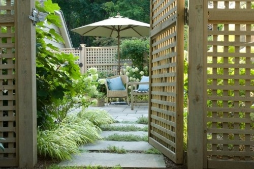 I love the fence and the entrance into this beautiful outdoor space