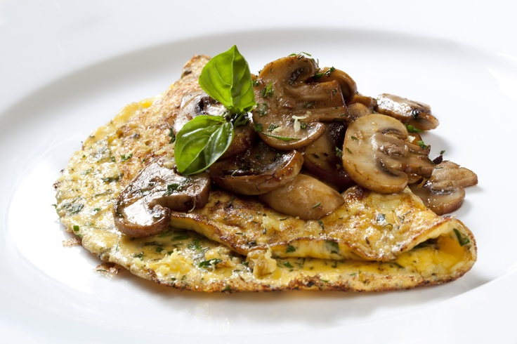 Organic omelette with mushrooms and herbs