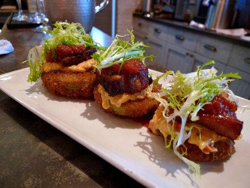 Fried green tomatoes topped with pimento cheese and thick bacon