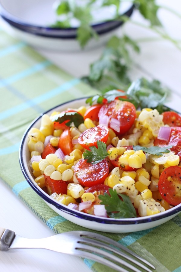 Fresh garden salad of sweet corn and cherry tomatoes: sprinkle on a ...