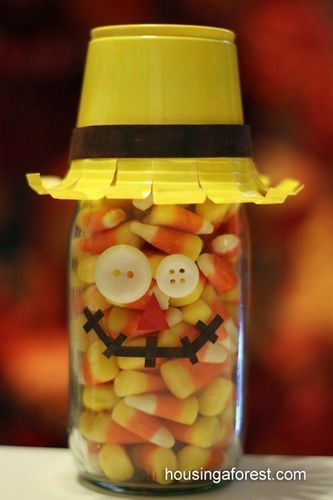 Fall Craft- scarecrow using glass jar, candy corn, yellow cup, button eyes.