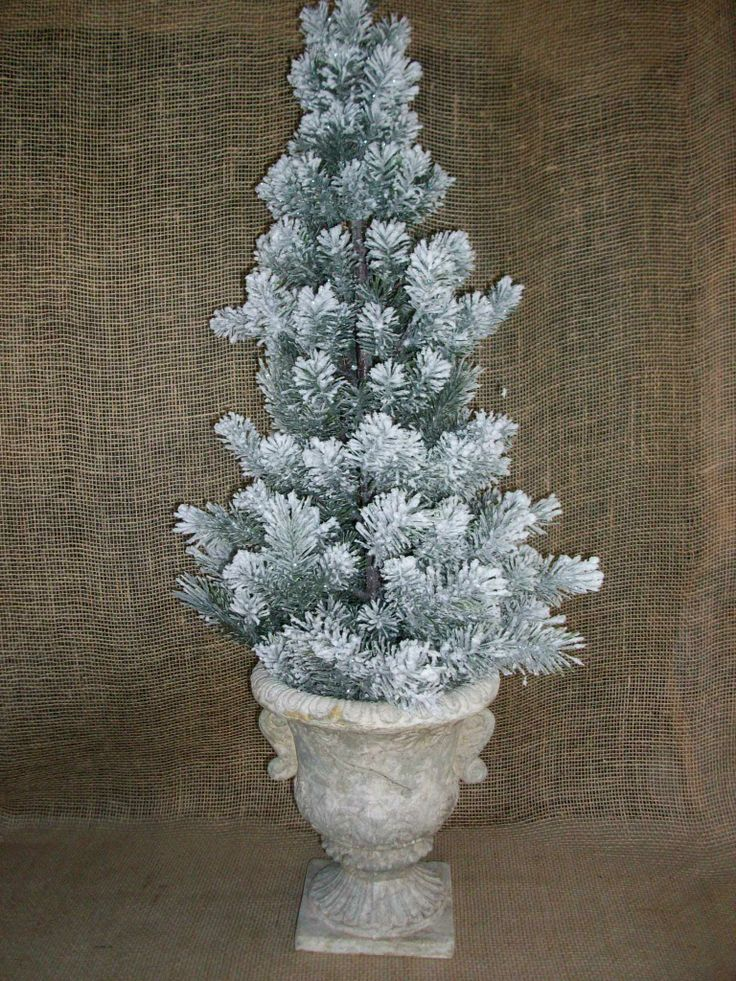 Christmas tree in urn sold black diamond memory furniture booth