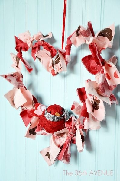 Valentine's wreath made from a hanger  and fabric scraps via The 36th Avenue blog.