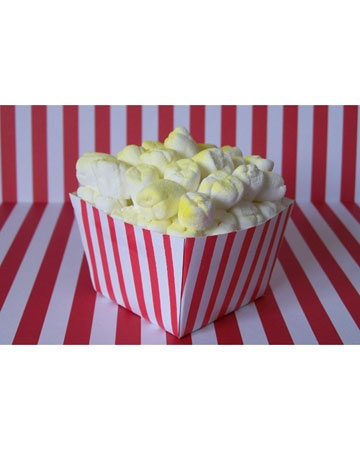 "Popcorn Cupcakes: This cinema-size cupcake pops out with buttery kernels of popped corn. User hollyce24 tops the vanilla cupcake with fluffy white icing, mini marshmallows, and a light spray of yellow ""butter."""