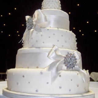 ... squares cakes with the diamond and pearls on the others. black ribbon