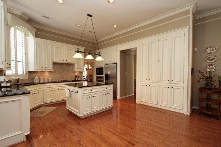Buttermilk cabinets fill the Island Kitchen creating such a fabulous