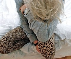 cheetah leggings. sweatshirt. watch. blonde hair.