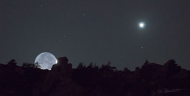 Earthshine and Venus Over Sierra de Guadarrama.  the Earth's Moon was caught just above the horizon in a young crescent phase. The familiar Moon might look a bit odd as the exposure shows significant Earthshine -- the illumination of the part of the Moon hidden from direct sunlight by the sun-reflecting Earth. Also captured in the image is the bright planet Venus on the right.