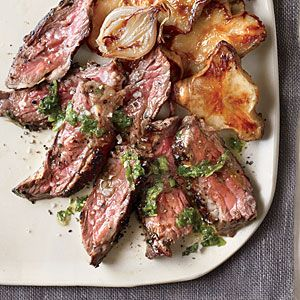 Grilled Skirt Steak with Mint Chimichurri and Honey-Roasted Sunchokes | MyRecipes.com