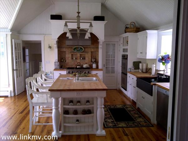 White kitchen cathedral ceiling home kitchens pinterest for Cathedral ceiling kitchen designs