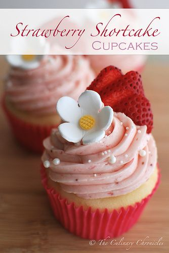 Strawberry Shortcake Cupcakes topped with Strawberry Swiss Meringue Buttercream