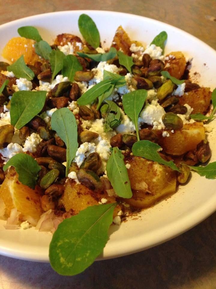 Orange Salad. Garnished with pistachios, fresh goat cheese and arugula ...