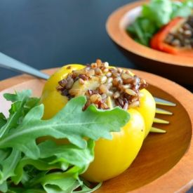 Bell peppers stuffed with wild rice, eggplant and zucchini.