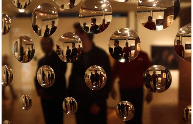 "People are seen through the acrylic bubbles of the art piece ""Concave Circles"" by Argentine artist Rogelio Polesello at the Museum of Modern Art in Mexico City April 1, 2012.Photograph by: Claudia Daut, Reuters"