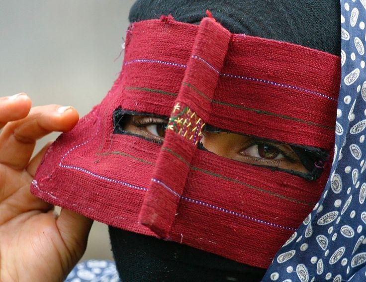 Masked Woman photographed at a produce market in Minab, Iran |  © Linda Cetacea