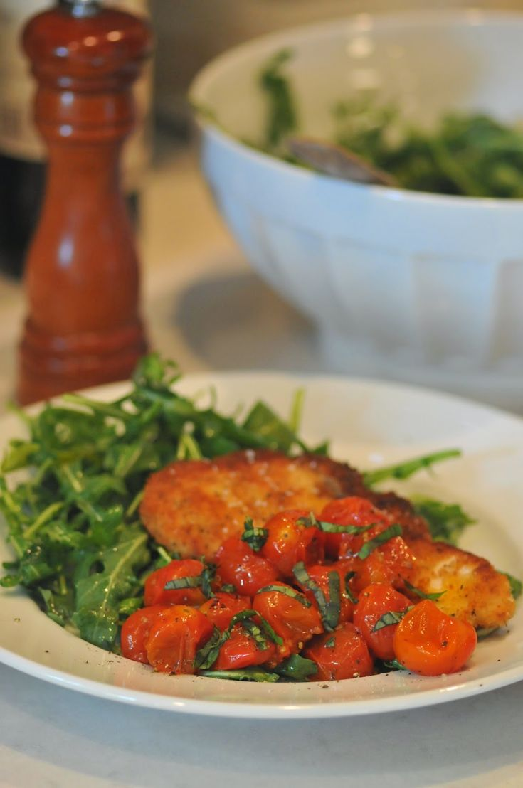 Chicken Milanese With Arugula And Tomatoes Recipe — Dishmaps