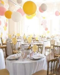 Balloons upside down, no helium needed.  I am in charge of decorations for my Aunts baby shower and this is pretty much what I am going for!  Pics to come!