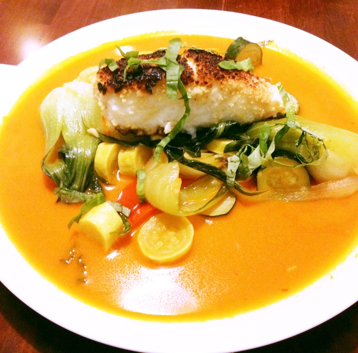 almond-crusted halibut with spring veggies in light yellow curry sauce