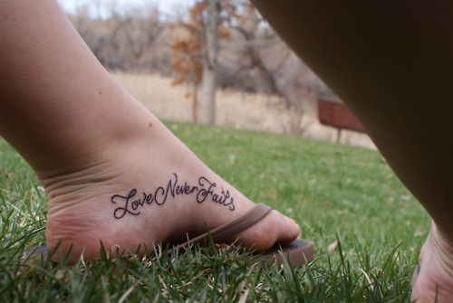 """Love Never Fails"" foot tattoo"