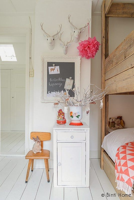 white-washed with soft wood and bright pink accents.  #kids #decor