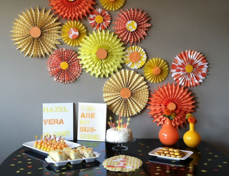 You Are My Sunshine Party - what a fab paper medallion backdrop! #kidsparty #partydecor