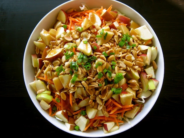 Cabbage salad with apples, carrots and peanuts