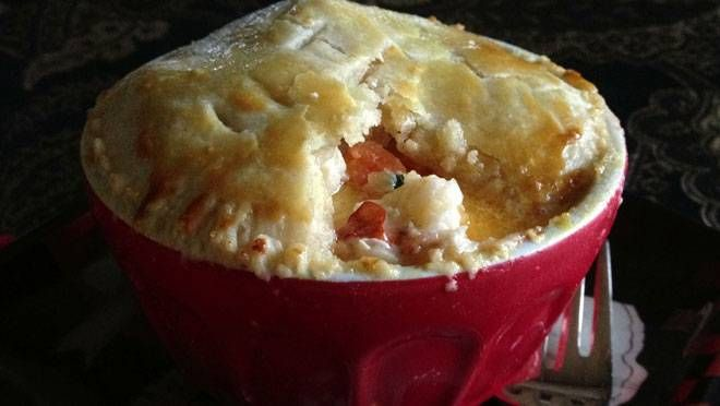speciality, this seafood pot pie features a casserole dish or pot ...