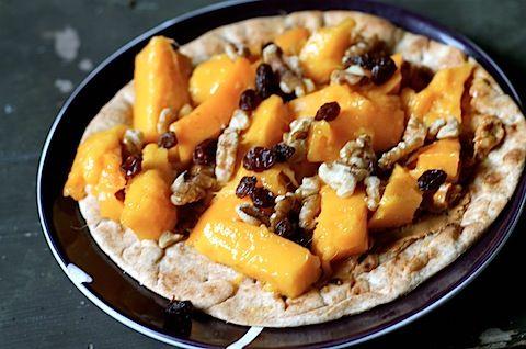 Breakfast pizza: pita with PB honey, mango, raisins, walnuts