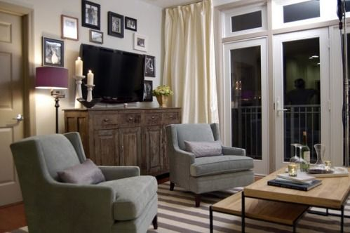Decorating around a flat screen tv with sconces geneieve gorder
