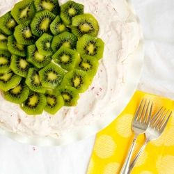 Traditional Pavlova with Strawberry Whipped Cream and fresh Kiwis ...