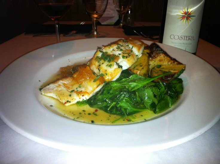 halibut served atop roasted Yukon gold potatoes and sautéed spinach ...