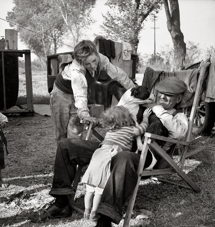 "November 1936. ""American River camp, Sacramento, California. Destitute family. Five children, aged two to seventeen years."""