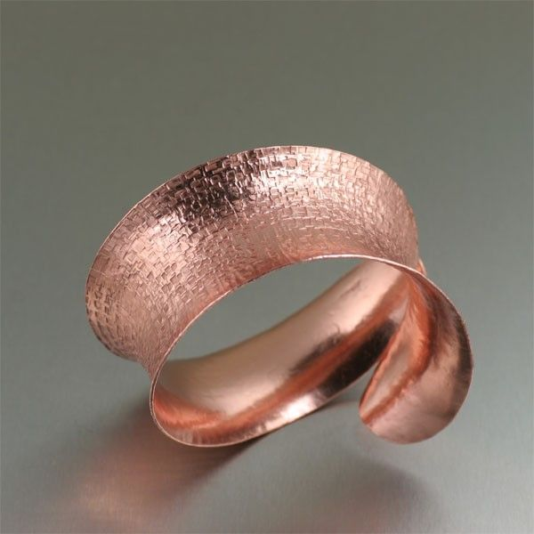 This #anticlastic handcrafted #copper #cuff bracelet is sure to make a statement.  Simply stunning, this bracelet features a deep textured pattern on the outside, complemented by a highly polished finished on the interior.