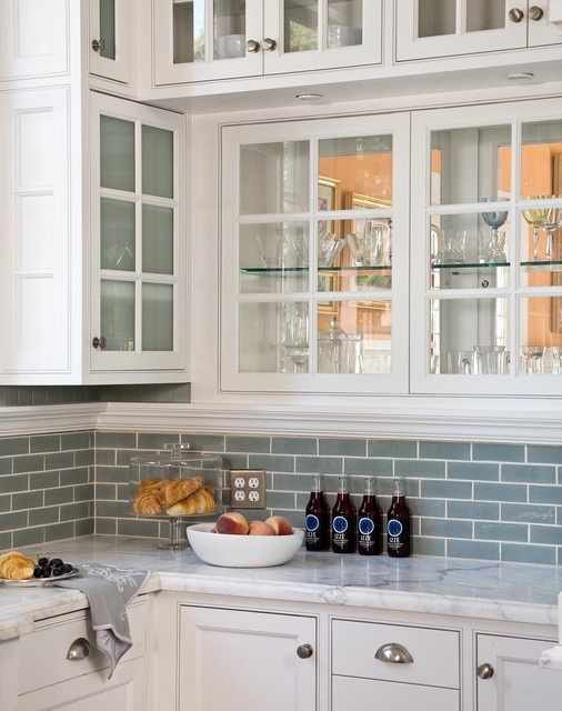 glass subway tile backsplash in blue with white glass front kitchen