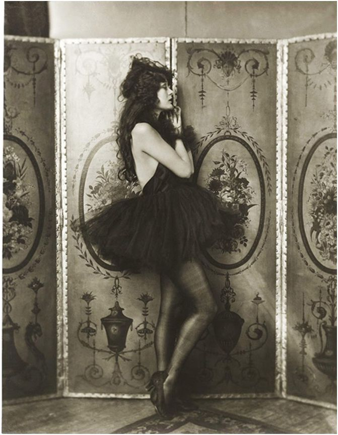 A portrait of Dolores Costello, Drew Barrymore's grandmother, leaning against a folding screen