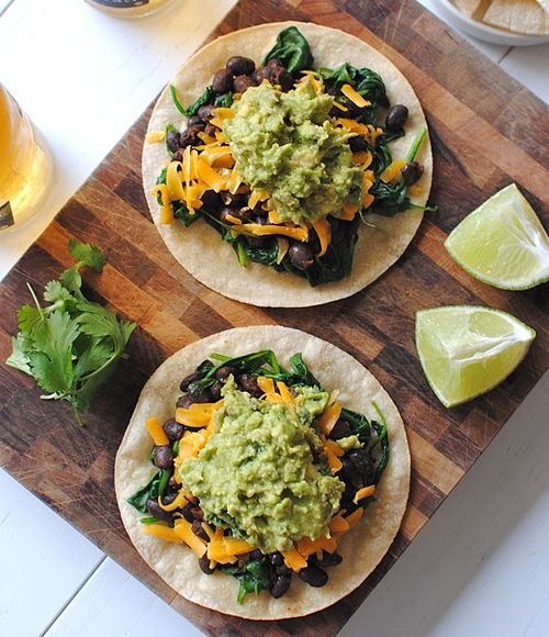 Easy Spinach, Black Bean and Guacamole Tostadas. Just ate on a plate ...