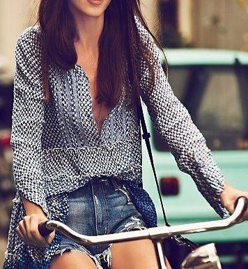 flowy blouse & distressed ripped denim shorts & cruiser bike