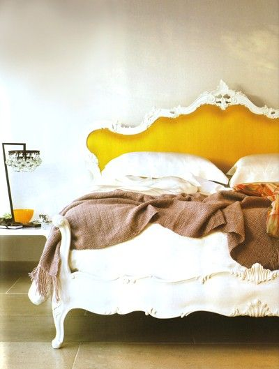 lovely. yellow bed with headboard