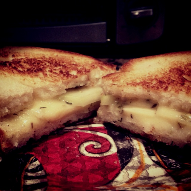 Brie and Pear grilled cheese sandwich. I added Oregano, Sage, Rosemary ...