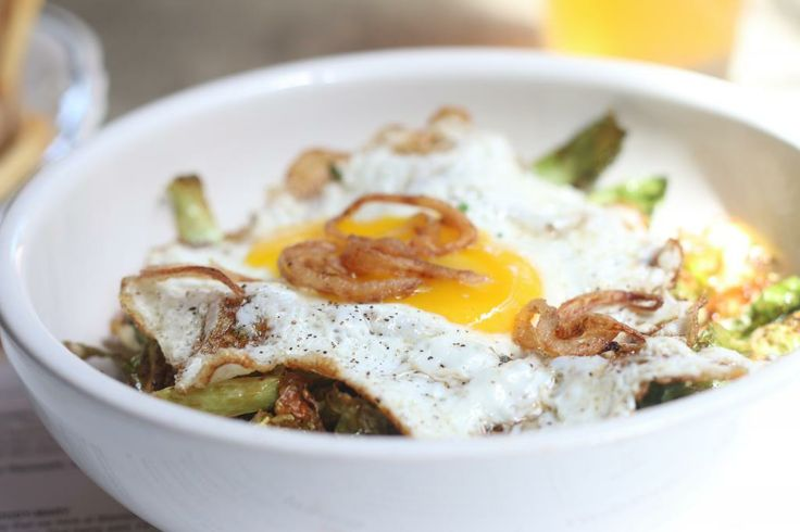 Crispy Brussels sprout, egg and shallots with a mustard vinaigrette.