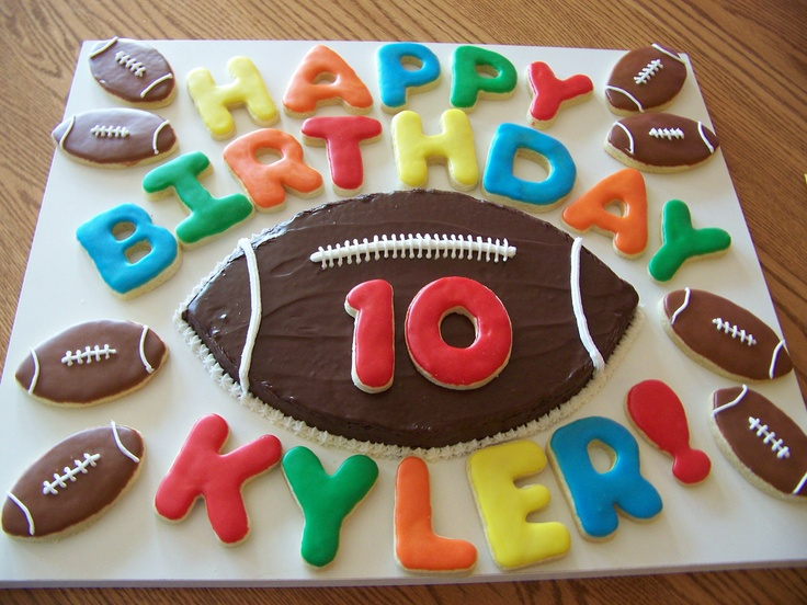 Football brownie cake and letter and football sugar cookies.